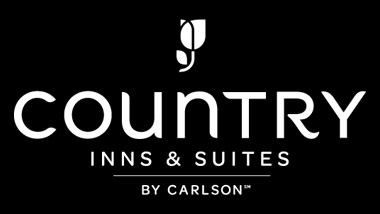 "The words ""Country Inns & Suites by Carlson in white on a black background."