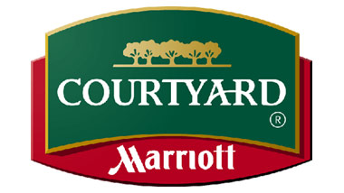 Logo for Courtyard by Marriott showing a block of green with gold trees overtop a block of red.