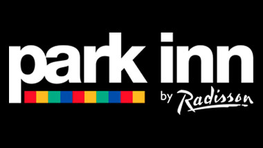 "The words ""Park Inn by Radisson"" in white on a black background with a multi-colored stripe under ""park."""
