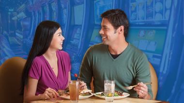 A young couple enjoys a meal at the Epic Buffet.