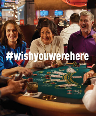 "group playing blackjack with text ""#WishYouWereHere"""